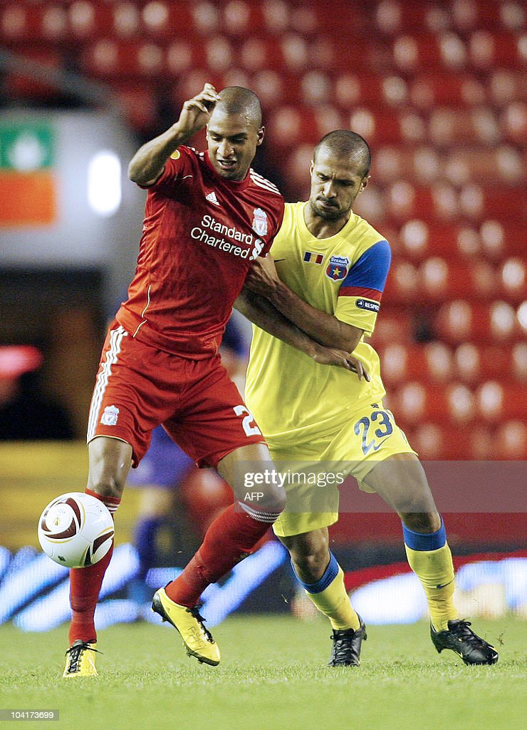 Liverpool's French forward David N'Gog (R) vies with Steaua Bucarest Portugese Defender Geraldo Alves during the UEFA Europa League football match Liverpool vs Steaua Bucarest, on September 16, 2010 at the Anfield stadium in Liverpool.