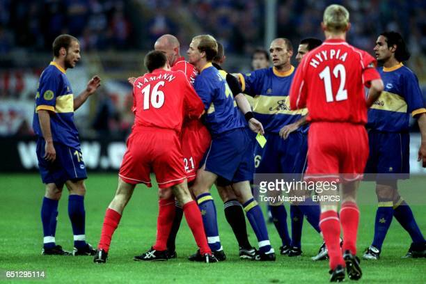 Liverpool's Gary McAllister is restrained by teammate Dietmar Hamann and Alaves' Jordi Cruyff after reacting to a bad challenge