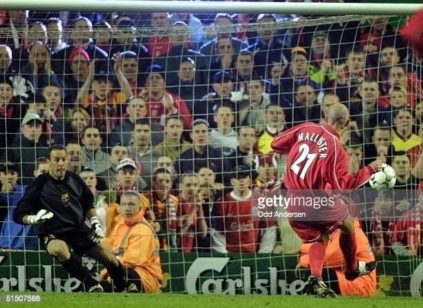 Liverpool's Gary McAllister puts a penalty kick behind Barcelona goalkeeper Jose Manual Reina at Anfield stadium in Liverpool, 19 April 2001 during...