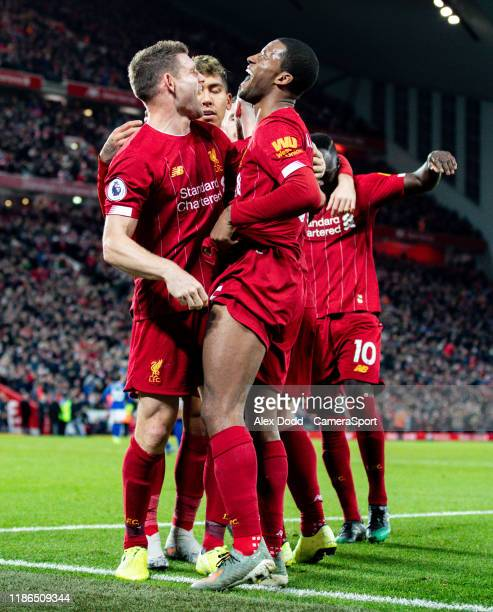 Liverpool's Georginio Wijnaldum celebrates scoring his side's fifth goal with teammates during the Premier League match between Liverpool FC and...