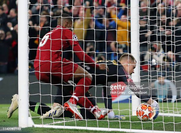 Liverpool's Georginio Wijnaldum grapples to recover the ball from Barcelona's MarcAndre ter Stegen after scoring his side's second goal during the...