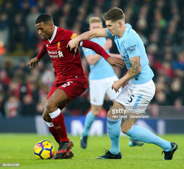 Liverpool's Georginio Wijnaldum holds off the challenge from Manchester City's John Stones during the Premier League match between Liverpool and...