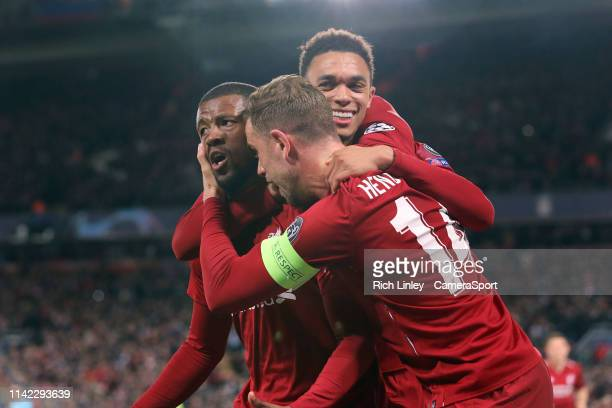 Liverpool's Georginio Wijnaldum is mobbed by Jordan Henderson and Trent AlexanderArnold as he celebrates scoring his side's third goal during the...