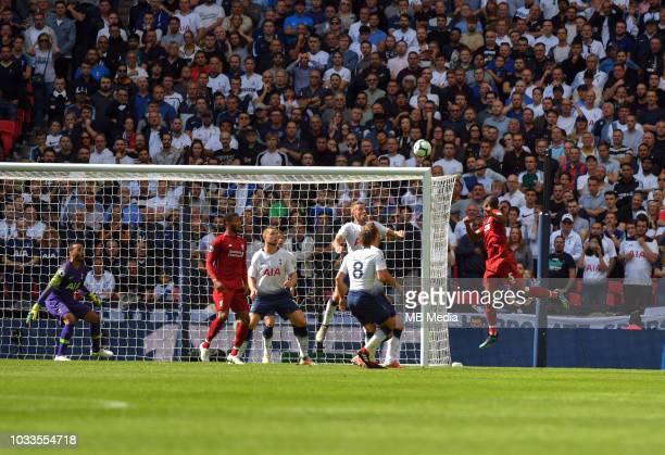 Liverpool's Georginio Wijnaldum scores the opening goal during the Premier League match between Tottenham Hotspur and Liverpool FC at Wembley Stadium...