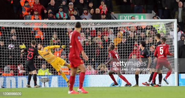 Liverpool's Georginio Wijnaldum scores the opening goal past Atletico Madrid's Jan Oblak during the UEFA Champions League round of 16 second leg...