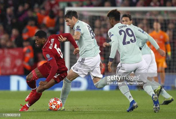 Liverpool's Georginio Wijnaldum under pressure from Bayern Munich's Javi Martinez and Kingsley Coman during the UEFA Champions League Round of 16...