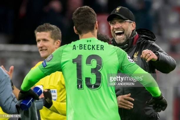 Liverpool's German coach Jurgen Klopp and Liverpool's Brazilian goalkeeper Alisson celebrate at the final whistle during the UEFA Champions League...
