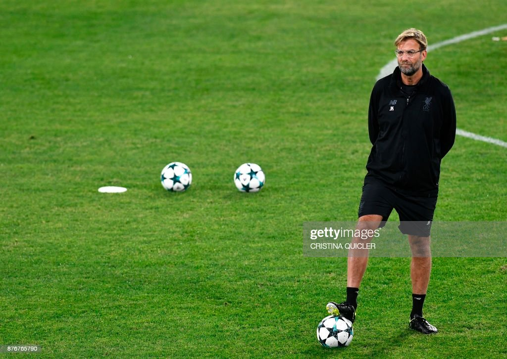 Liverpool's German coach Jurgen Klopp attends a training session at Ramon Sanchez Pizjuan stadium in Sevilla on November 20, 2017 on the eve of the UEFA Champions League group E football match between Sevilla and Liverpool. /