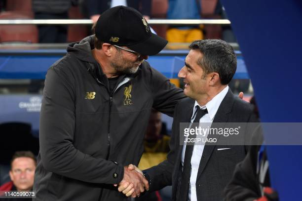 Liverpool's German coach Jurgen Klopp Barcelona's and Spanish coach Ernesto Valverde shake hands before the UEFA Champions League semifinal first leg...