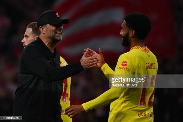 Liverpool's German coach Jurgen Klopp celebrates with Liverpool's English defender Joe Gomez at the end of the UEFA Champions League Group B football...