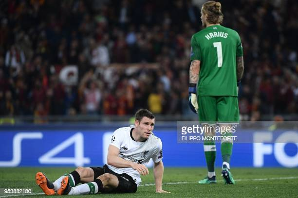 Liverpool's German goalkeeper Loris Karius and Liverpool's English midfielder James Milner react after Roma's second goal during the UEFA Champions...