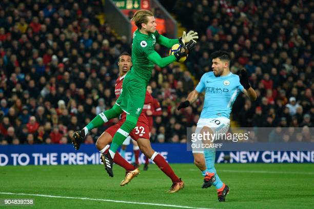 Liverpool's German goalkeeper Loris Karius comes out to cut out a cross away from Manchester City's Argentinian striker Sergio Aguero during the...