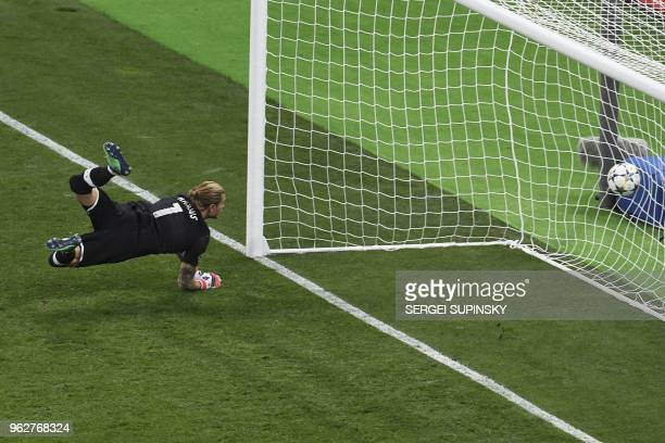 Liverpool's German goalkeeper Loris Karius fails to save the 21 shot by Real Madrid's Welsh forward Gareth Bale during the UEFA Champions League...