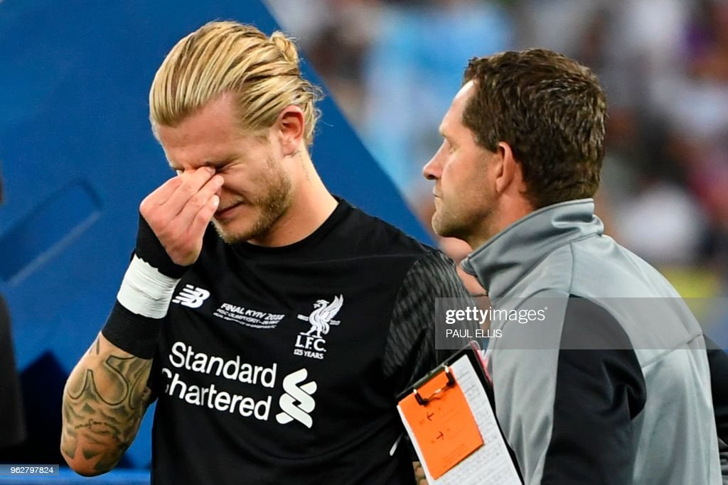 Liverpool's German goalkeeper Loris Karius reacts on the pitch after the UEFA Champions League final football match between Liverpool and Real Madrid at the Olympic Stadium in Kiev, Ukraine on May 26, 2018. - Real Madrid defeated Liverpool 3-1.