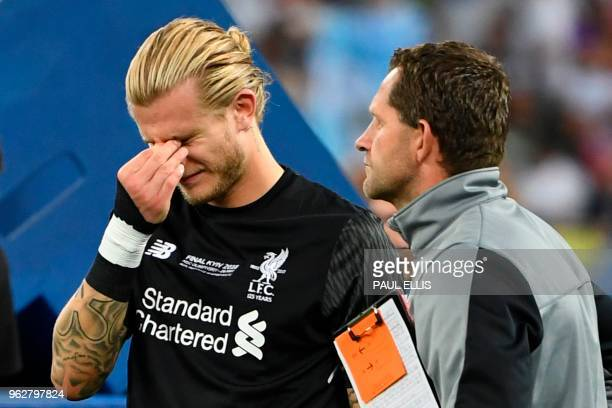 Liverpool's German goalkeeper Loris Karius reacts on the pitch after the UEFA Champions League final football match between Liverpool and Real Madrid...