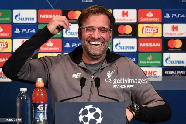Liverpool's German head coach Jurgen Klopp laughs as he gives a press conference at the Parc des Princes stadium in Paris on November 27 2018 on the...