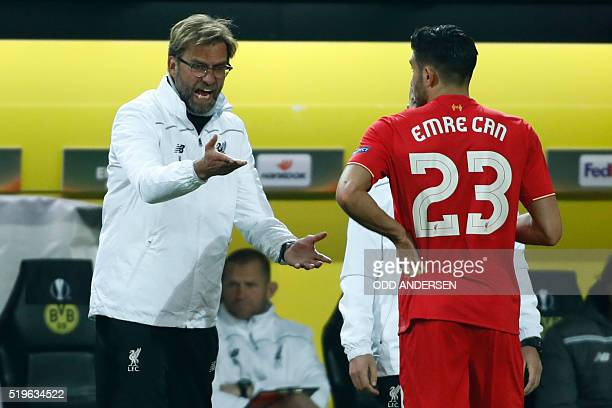 Liverpool's German head coach Jurgen Klopp speaks with Liverpool's German midfielder Emre Can during the UEFA Europe League quarterfinal firstleg...