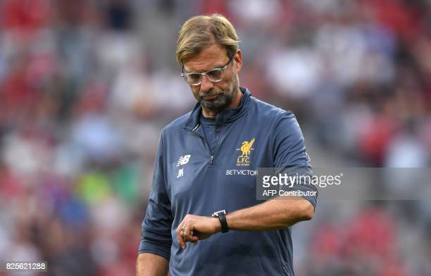 Liverpools German headcoach Juergen Klopp looks at his clock prior the final Audi Cup football match between Atletico Madrid and FC Liverpool in the...
