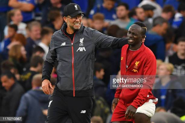 Liverpool's German manager Juergen Klopp gestures to Liverpool's Senegalese striker Sadio Mane on the pitch after the English Premier League football...