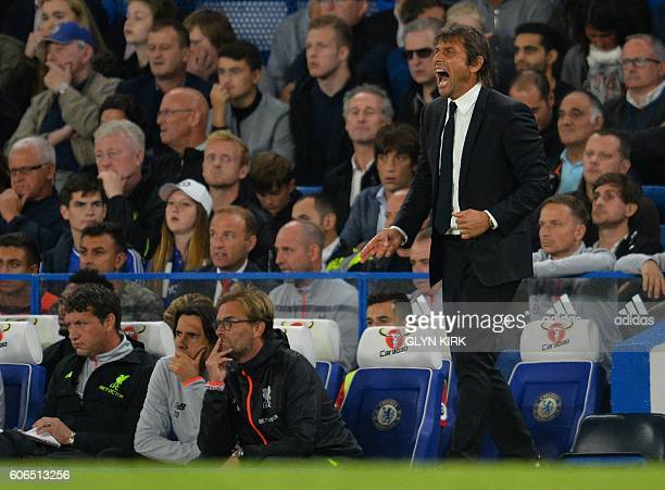 Liverpool's German manager Jurgen Klopp and Chelsea's Italian head coach Antonio Conte watch thier players during the English Premier League football...
