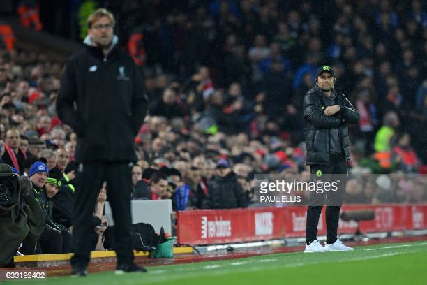 Liverpool's German manager Jurgen Klopp and Chelsea's Italian head coach Antonio Conte watch the players from the touchline during the English...
