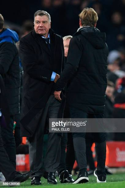 Liverpool's German manager Jurgen Klopp and Everton's English manager Sam Allardyce shake hands at the end of the English Premier League football...
