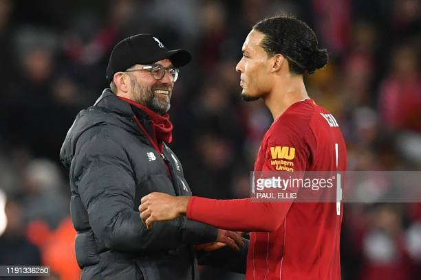 Liverpool's German manager Jurgen Klopp and Liverpool's Dutch defender Virgil van Dijk reacts at the final whistle during the English Premier League...