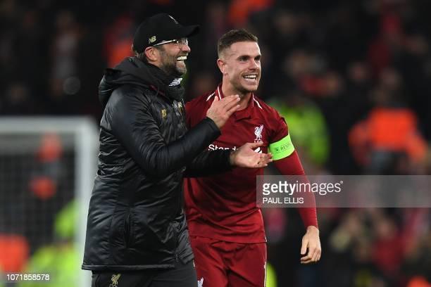 Liverpool's German manager Jurgen Klopp and Liverpool's English midfielder Jordan Henderson applauds the fans following the UEFA Champions League...
