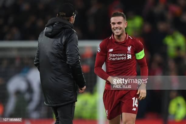 Liverpool's German manager Jurgen Klopp and Liverpool's English midfielder Jordan Henderson celebrate following the UEFA Champions League group C...