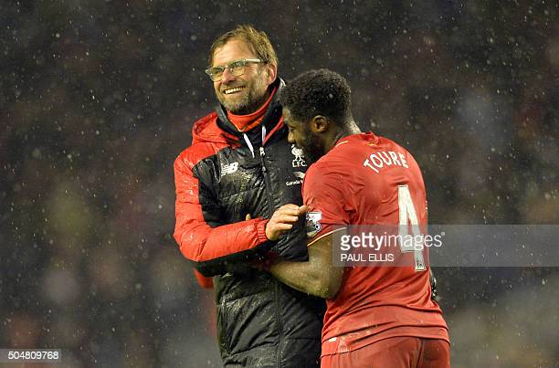 Liverpool's German manager Jurgen Klopp and Liverpool's Ivorian defender Kolo Toure celebrate after winning the English Premier League football match...