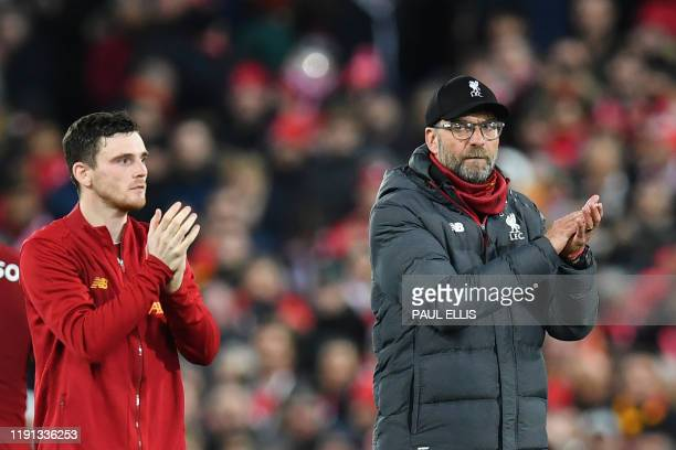 Liverpool's German manager Jurgen Klopp and Liverpool's Scottish defender Andrew Robertson reacts at the final whistle during the English Premier...