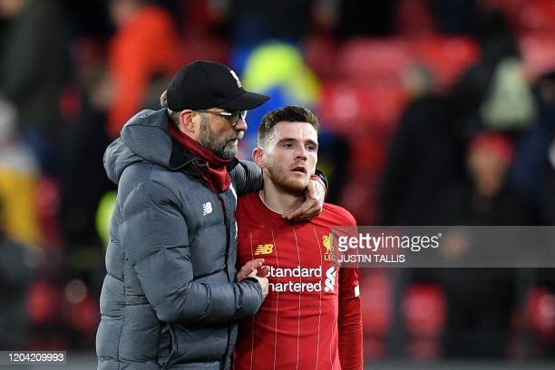 Liverpool's German manager Jurgen Klopp and Liverpool's Scottish defender Andrew Robertson react at the final whistle during the English Premier...
