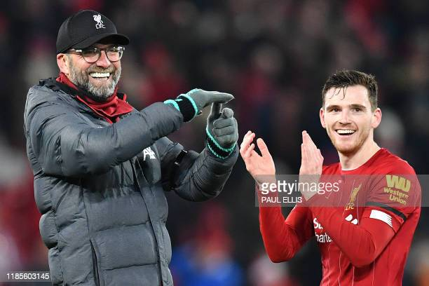 Liverpool's German manager Jurgen Klopp and Liverpool's Scottish defender Andrew Robertson applaud the fans following the English Premier League...