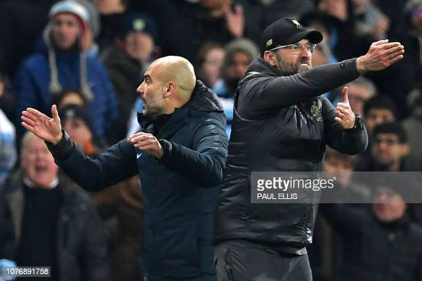 Liverpool's German manager Jurgen Klopp and Manchester City's Spanish manager Pep Guardiola gesture on the touchline during the English Premier...