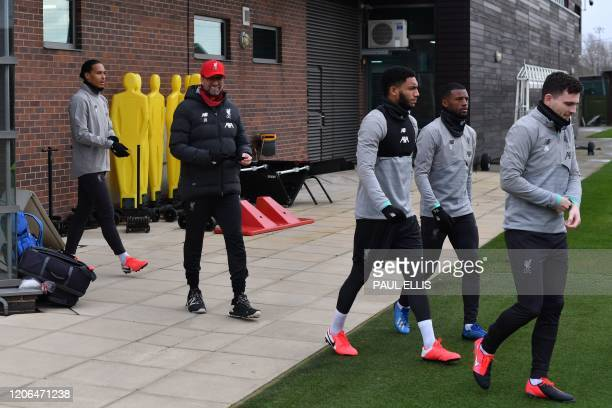 Liverpool's German manager Jurgen Klopp and players attend a training session at Melwood in Liverpool north west England on March 10 on the eve of...