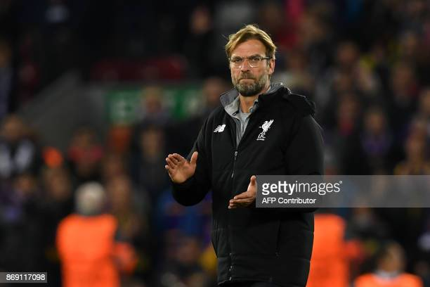 Liverpool's German manager Jurgen Klopp applauds supporters on the pitch after the UEFA Champions League Group E football match between Liverpool and...