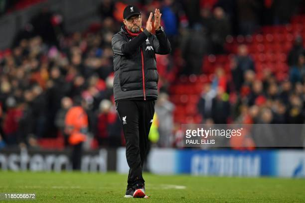 Liverpool's German manager Jurgen Klopp applauds the fans following the UEFA Champions league Group E football match between Liverpool and Napoli at...