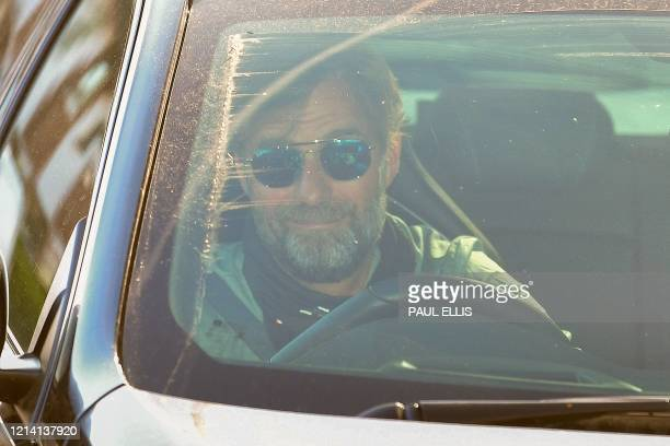 Liverpool's German manager Jurgen Klopp arrives at Melwood in Liverpool north west England to resume training on May 20 as training resumes after the...