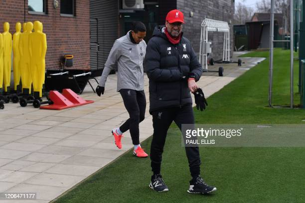 Liverpool's German manager Jurgen Klopp attends a training session at Melwood in Liverpool north west England on March 10 on the eve of their UEFA...