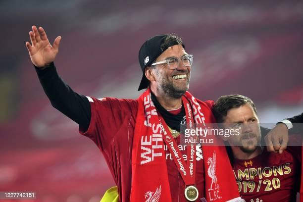 Liverpool's German manager Jurgen Klopp celebrates during the Premier League trophy presentation following the English Premier League football match...