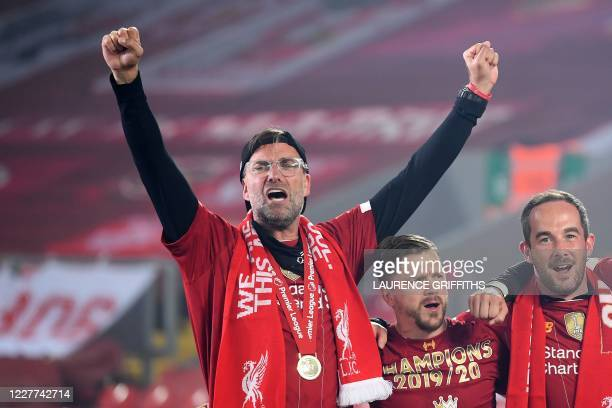 Liverpool's German manager Jurgen Klopp celebrates during the Premier League trophy presentation following the English Premier League football match...