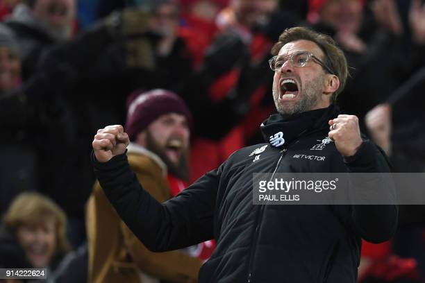 Liverpool's German manager Jurgen Klopp celebrates Liverpool's Egyptian midfielder Mohamed Salah scoring the team's second goal during the English...