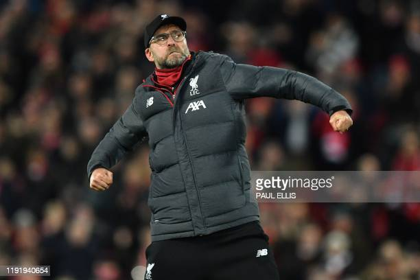 Liverpool's German manager Jurgen Klopp celebrates on the pitch after the English FA Cup third round football match between Liverpool and Everton at...