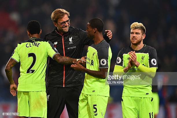 Liverpool's German manager Jurgen Klopp celebrates on the pitch with Liverpool's English defender Nathaniel Clyne Liverpool's Dutch midfielder...