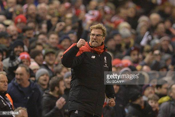 Liverpool's German manager Jurgen Klopp celebrates their late equalising goal to level the score at 22 the English Premier League football match...