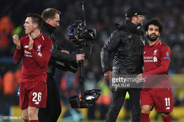 Liverpool's German manager Jurgen Klopp celebrates with Liverpool's Egyptian midfielder Mohamed Salah and Liverpool's Scottish defender Andrew...