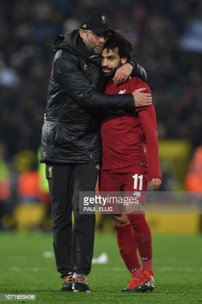 Liverpool's German manager Jurgen Klopp celebrates with Liverpool's Egyptian midfielder Mohamed Salah after the UEFA Champions League group C...
