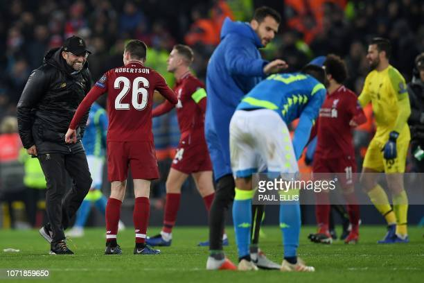 Liverpool's German manager Jurgen Klopp celebrates with Liverpool's Scottish defender Andrew Robertson after the UEFA Champions League group C...
