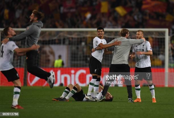 Liverpool's German manager Jurgen Klopp celebrates with Liverpool's Estonian defender Ragnar Klavan and Liverpool's English striker Dominic Solanke...