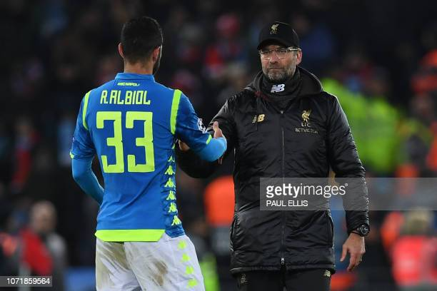 Liverpool's German manager Jurgen Klopp commiserates Napoli's Spanish defender Raul Albiol following the UEFA Champions League group C football match...